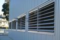 Curtain Wall Louvers : Motorized aerofoil sun louver