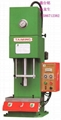 A small desktop hydraulic press 3