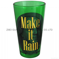 colored pint glass with gold logo