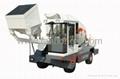 Self-loading mobile concrete mixer