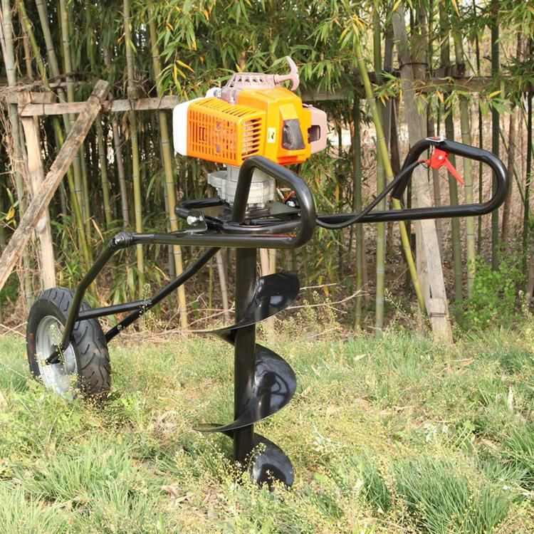 Hand-held earth auger