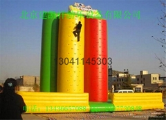Children's inflatable climbing wall in the castle