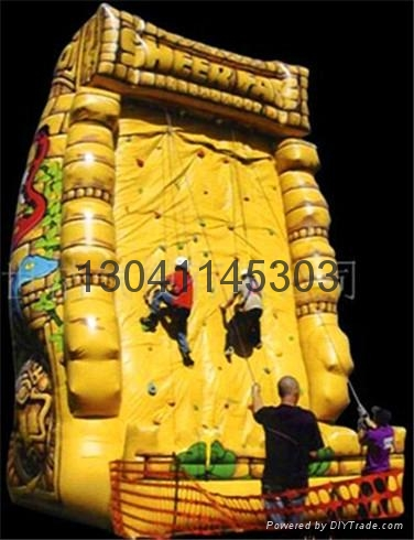 Children's inflatable climbing wall in the castle 2