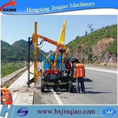 Highway guardrail post drilling machine