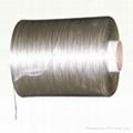 Low dielectric loss glass fiber