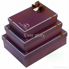 Nested cardboard set up gift box with ribbon bow