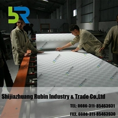 Gypsum board laminating
