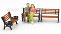 Mini outdoor bench with people's figure