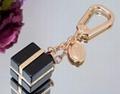 LOUIS VUITTON Gold LV Facettes Monogram Key Chain Bag Charm Key Holder