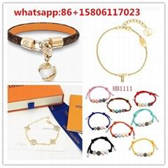 bracelet with monogram straps and engraced locks               bracelet