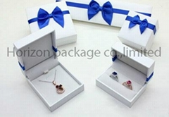 Beautiful plastic jewelry box with art paper cover