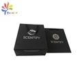 Black paper bag with silver logo