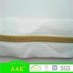 3号尼龙金牙白色布带金色中心线码装拉链