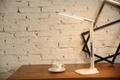 Folding LED desk lamp with LCD calendar and alarm clock
