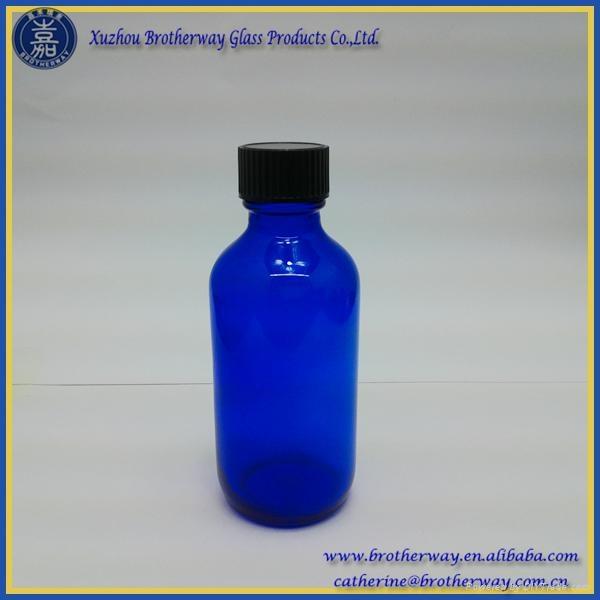 cb6cc9885822 2oz Blue Boston Round Glass Bottle with Phenolic Cap - BWBB2 ...