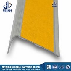 Beveled carborundum slip proof stair treads with anodized aluminum profile