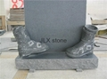Grey granite headstone with shoes for