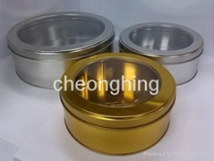 Round metal tin box with window