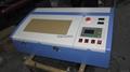 laser engraving machine on wood veneer