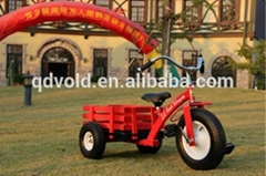 kids tricycle with trailer