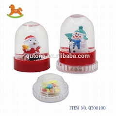 Hot selling revo  ing plastic Christmas ball toy with sweet   candy in display