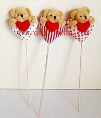 stuffed valnetine's bear head with heart and stick