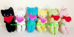 different color plush cat with heart with hanging cord