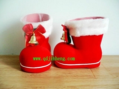 red plastic Christmas boots with bell and bow
