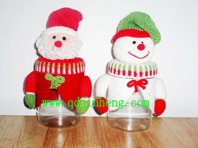 santan and snowman head with plastic bottle for candy