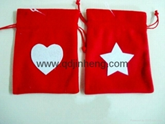 red gift bag with drawstring top