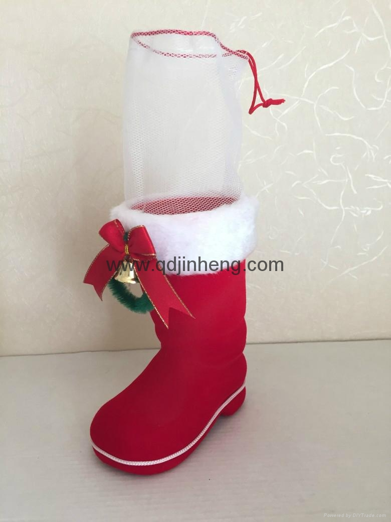 red plastic chrsistmas boots for holding candy