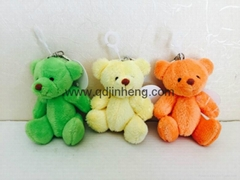 sitting plush bear in green/yellow/orange