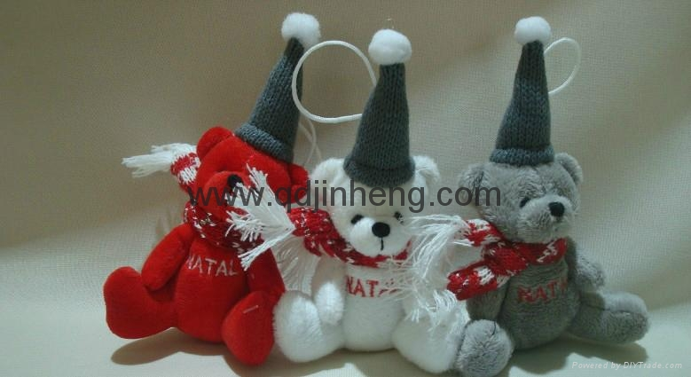 sitting bear with christmas hat and scarf