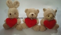 three stuffed animals with heart for