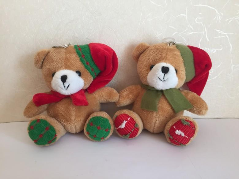 stuffed bear with christmas scarf and hat