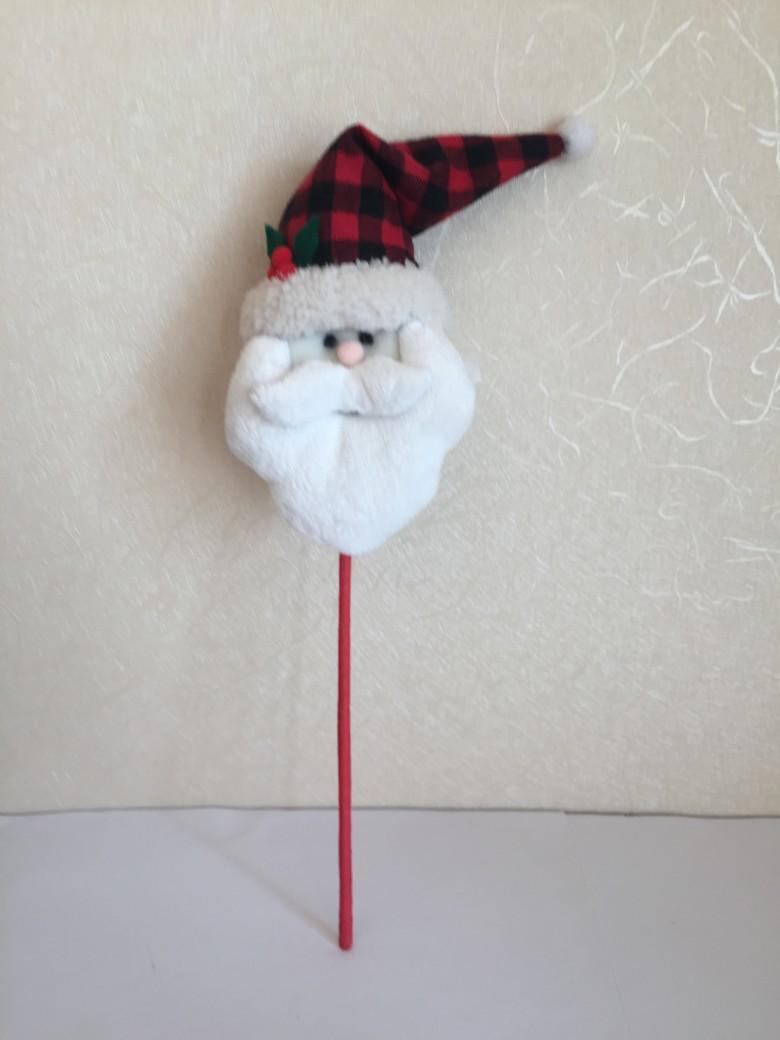 stuffed santa claus head sticking