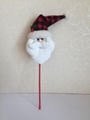 stuffed santa claus head sticking