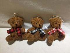 Plush scarf sitting bear