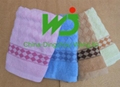 Different colours beach towels in stock