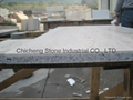Natural stone laminated with granite and