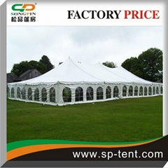 12x24m Pole Tent with Windows and Sides Secured to Grass Ground by Pegs and Rope