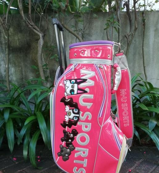 M U Sports golf caddy bag rolling sole