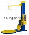 Pallet wrapping machine with top press