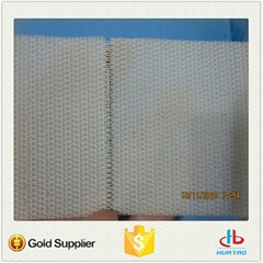 Woven dryer fabric with round monofilament polyester yarns