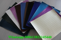 Wholesale high gloss pvc artificial embossed leather for ladybags and luggage