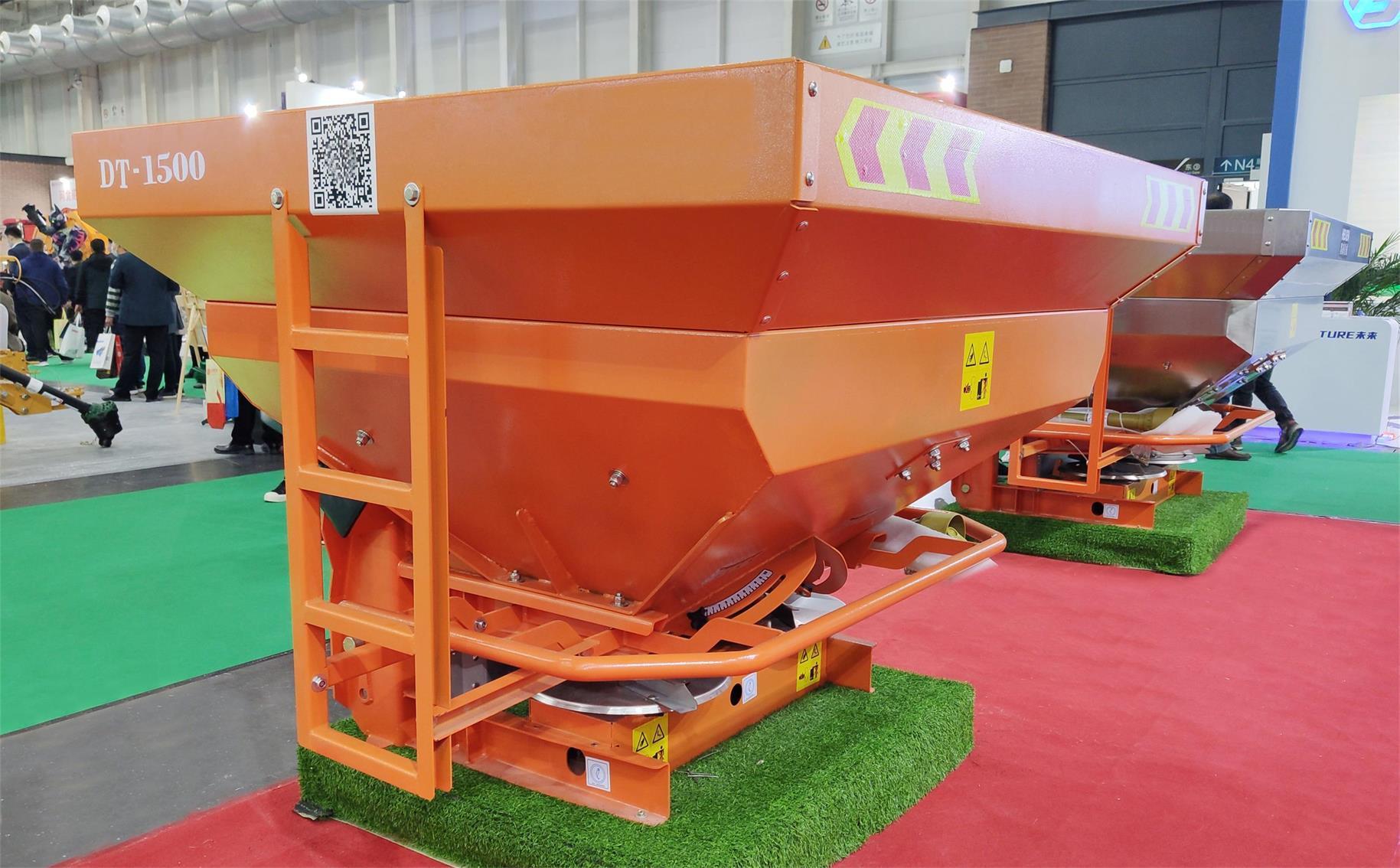 Tractor mounted fertilizer spreader