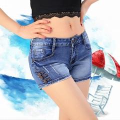春夏新款女装低腰牛仔个性纯色热裤磨白破洞牛仔短裤