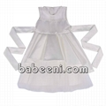 White sleeveless party dress with flower