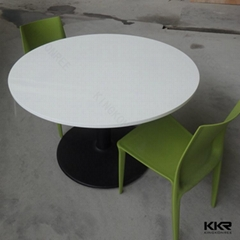 Black round solid surface dining table