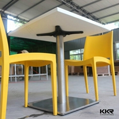 Small square solid surface dining table with chair